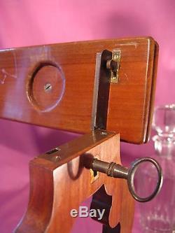 Ancienne cave à whisky en acajou à système de fermeture